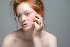 Eye ring handmade in 925 sterling silver worn by a model with red hair