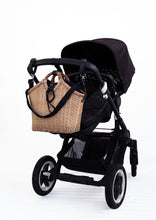 Load image into Gallery viewer, Pako stroller bag in bamboo with the Black bag hanging on a black pram. Pako bambuväska handgjord med en svart tygväska hängandes på en svart barnvagn