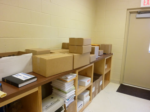 Boxes of A Defense of the Church Institutue, ready for distribution to Book Club members in various congregations via the Book Club Agents.