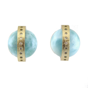 Marcia Moran A half dome of a larimar is crossed by an 18k gold plated band inset with CZ