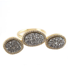 Three oval stones ensconced in CZ link to a single band with built in sizer to fit ring sizes 6-8 titanium druzy