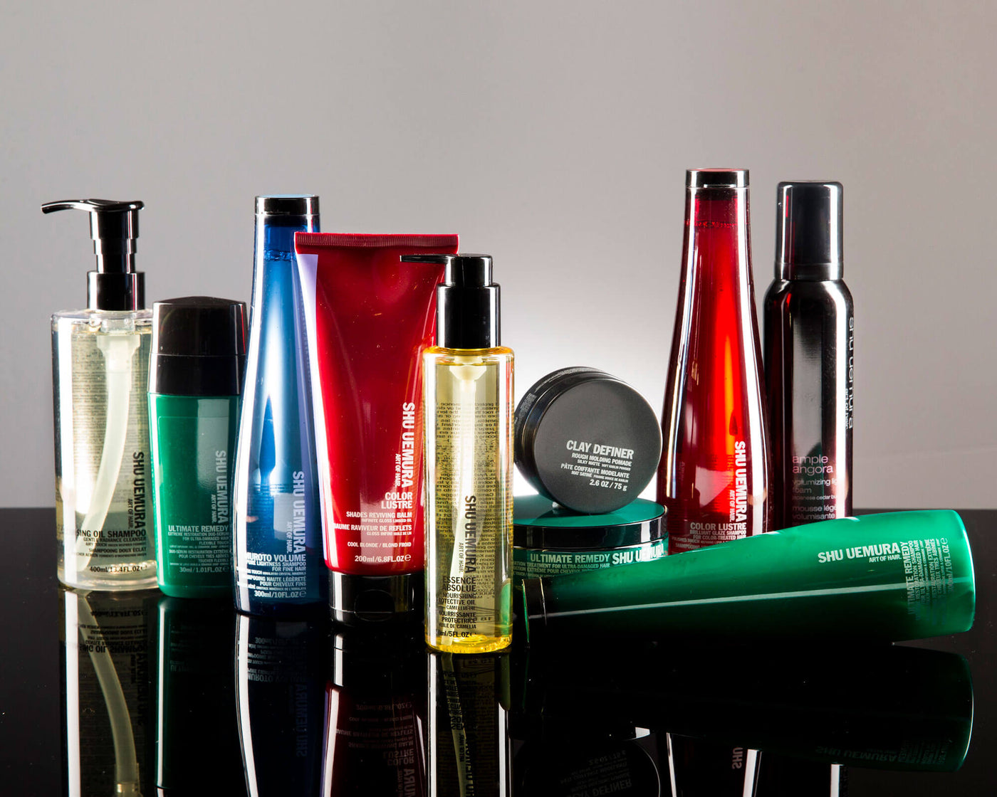 Shu Uemura bottles and tubes in multiple colours