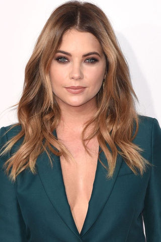 Ashley Benson with warm balayage and layered haircut