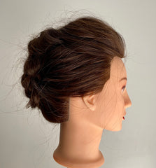 Braided updo on mannequin head profile view