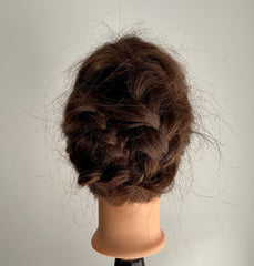 Braided updo on mannequin head