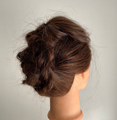 Braided updo on mannequin head side view