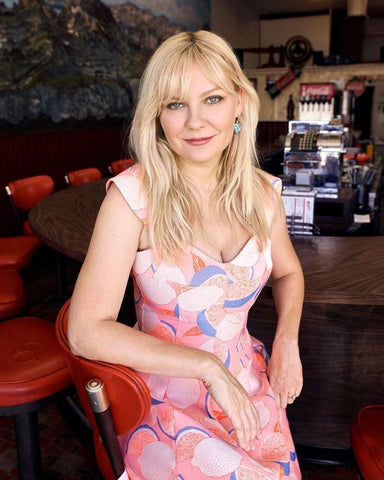 Kirsten Dunst with shaggy haircut and curtain fringe