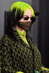 Billie Eilish with black hair and neon green roots