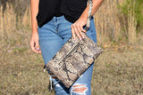 Only the Good Brown Snakeskin Clutch