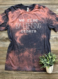 We Rise by Lifting Others Graphic Tee
