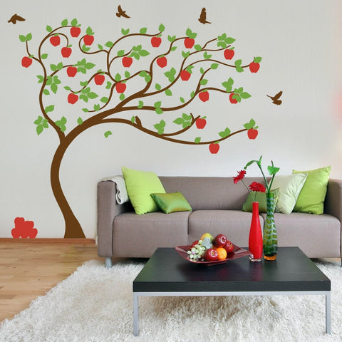 Wall art decals of trees with leaves and birds.