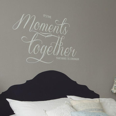 Moments together mockup above a bed