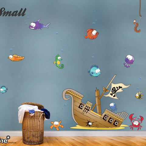 Kids wall sticker designs of underwater scene with pirate ship and big eyed fish.