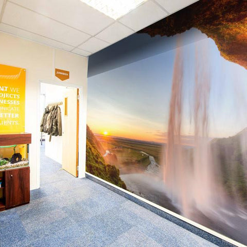 Sunny waterfall wall covering installed in an office space