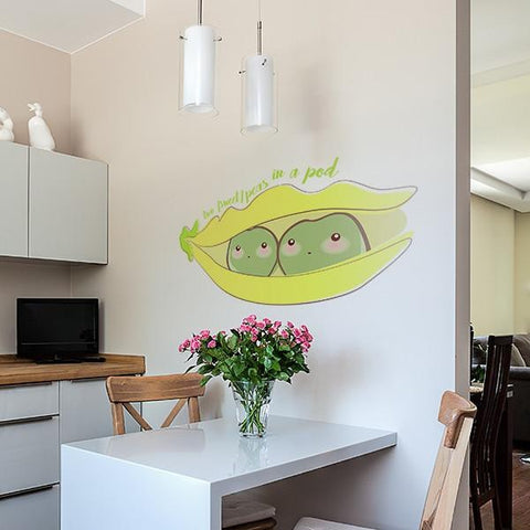 Sweet peas in a pod sticker mockup above kitchen table - square crop