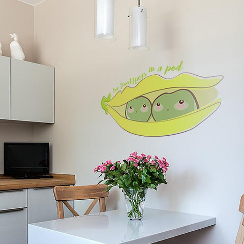 Sweet peas in a pod sticker mockup above kitchen table