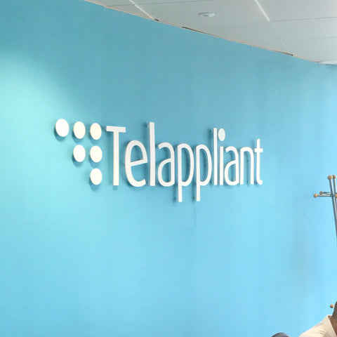White Acrylic Letters 5mm on Blue wall in office in London