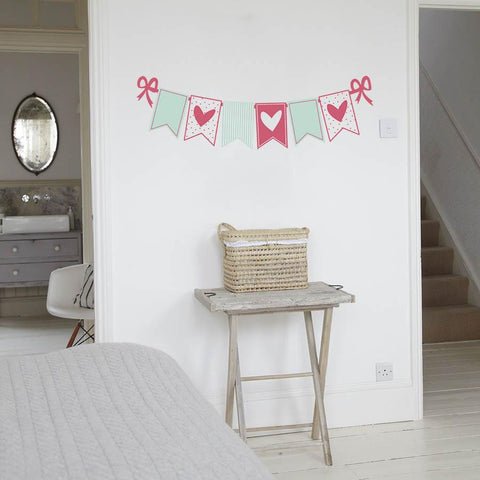 Bunting wall sticker decal with heart pattern.