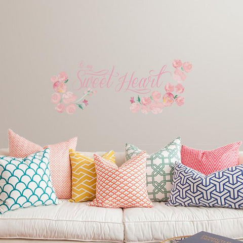 Sweetheart printed sticker mockup above sofa