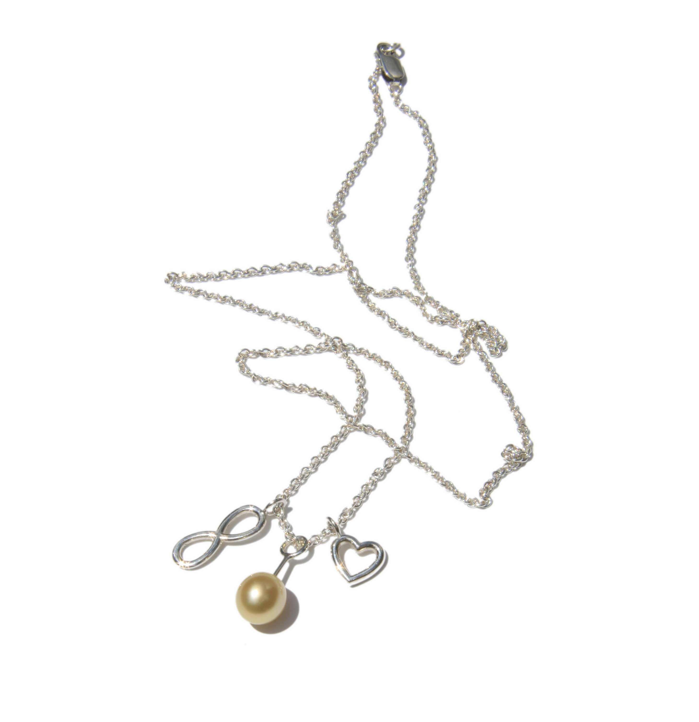 Necklace with yellow pearl and two charms