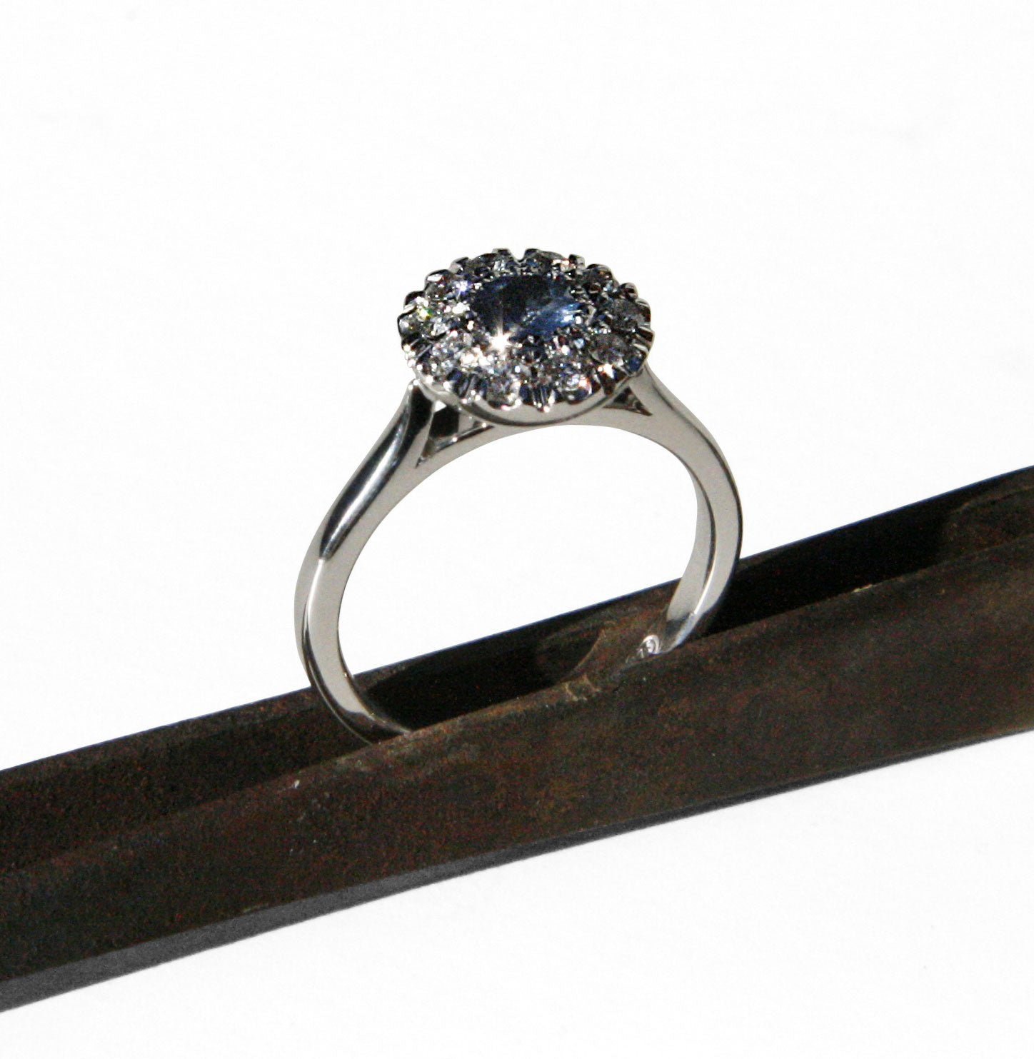 Sapphire and diamond 'button' engagement ring