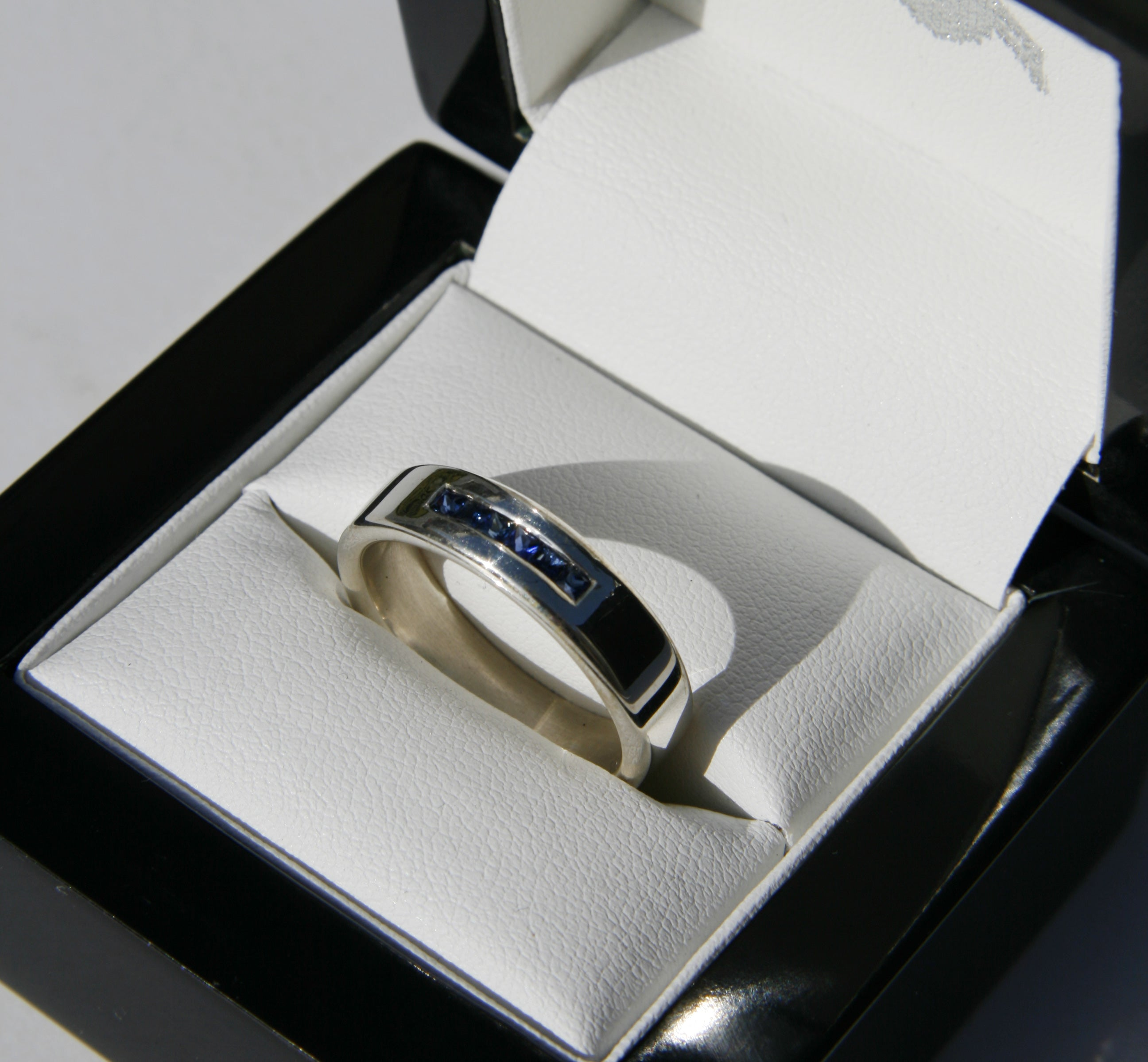 Channel set Sapphire and Silver ring
