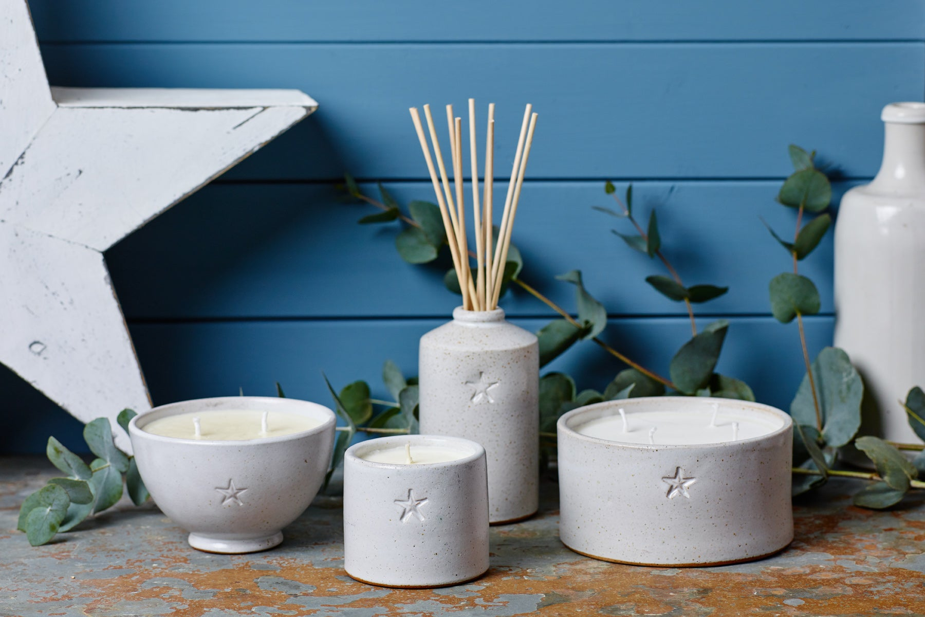 the Kiln Collection by Parkminster - Hand trown ceramic containers filled with beautiful and bespoke scented candles and diffusers