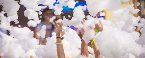 foam party with hands extending out from foam