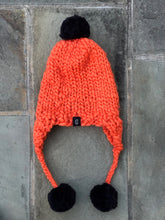 Load image into Gallery viewer, Handmade Aviator Hat | Orange with Black PomPoms