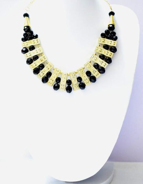 HIRNYA BLACK AND GOLD NECKLACE