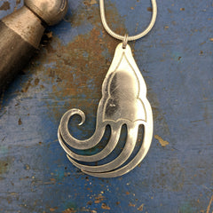 Feathered fish fork pendant