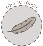"An circle icon picturing a feather with the words ""Soft to touch"" over the top"