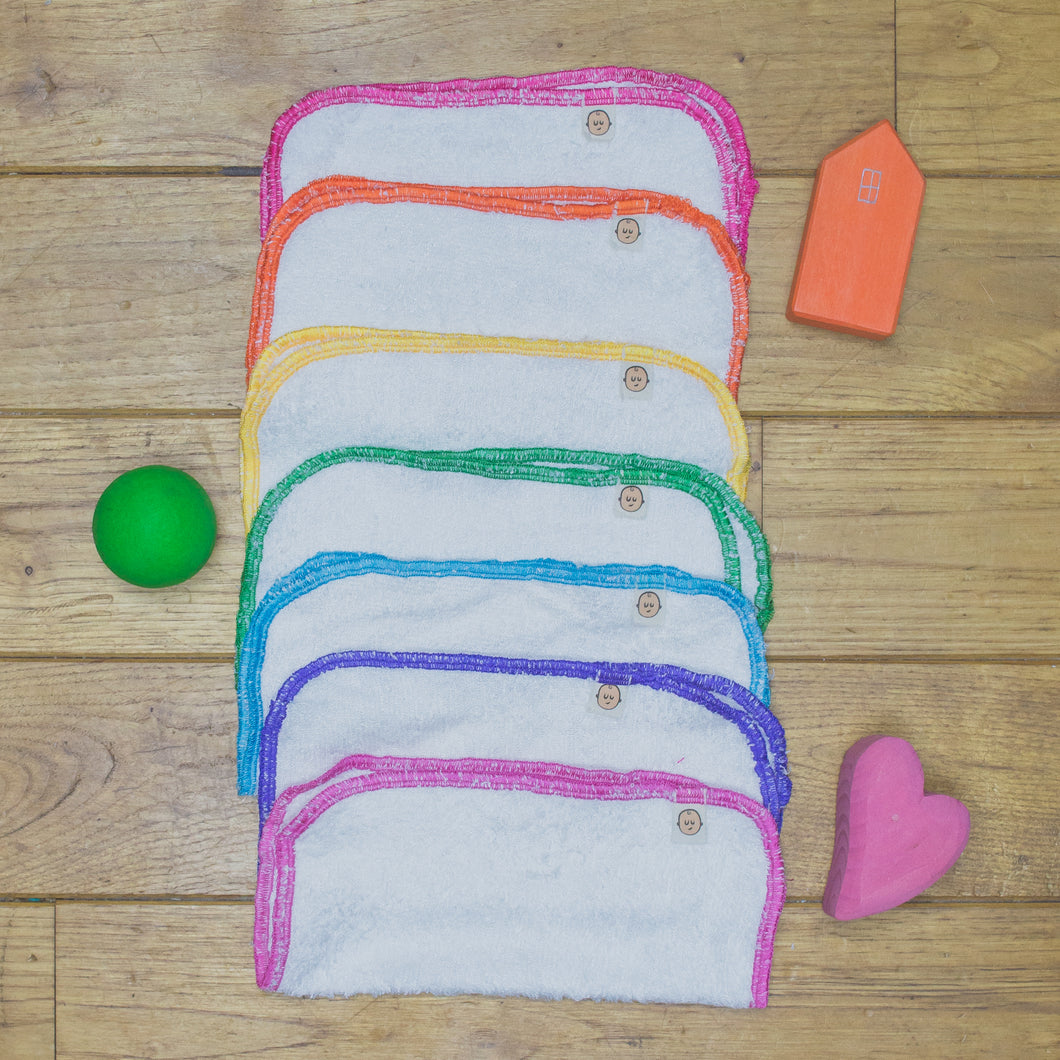 7 Poco Bambino reusable wipes made from Bamboo Terry with an organic cotton rainbow trim