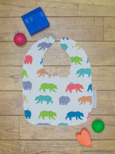 Load image into Gallery viewer, An organic Poco Bambino bib. The print is rainbow bear hike design.