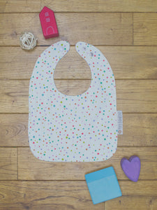 An organic Poco Bambino bib. The print is multicoloured spots design.