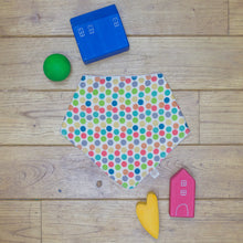 Load image into Gallery viewer, An organic Poco Bambino dribble bib. The print is a rainbow spots design.