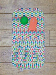 A set of 5 Organic Poco Bambino reusable wash cloths / wipes in a rainbow dots print.