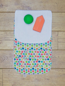 A set of 5 Organic Poco Bambino reusable wash cloths / wipes in a rainbow dots print. The top wipe is folded down to show the soft bamboo terry reverse.