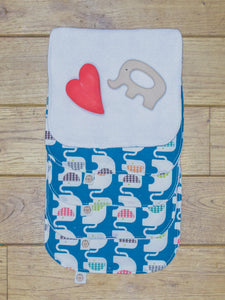 A set of 5 Organic Poco Bambino reusable wash cloths / wipes in a blue print with rainbow elephants. The top wipe is folded down to show the soft bamboo terry reverse.