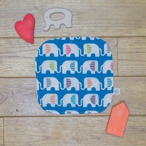 An Organic Poco Bambino reusable wash cloth / wipe in a blue print with rainbow elephants.