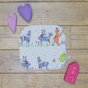 An Organic Poco Bambino reusable wash cloth / wipe in a multicoloured spots and animal parade print.