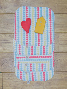 A set of 5 Organic Poco Bambino reusable wash cloths / wipes in a multicoloured dots print.