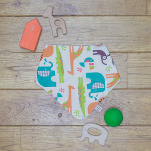 An organic Poco Bambino dribble bib. The print is a jungle animal design.