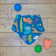 Load image into Gallery viewer, An organic Poco Bambino dribble bib. The print is a jungle animal design.