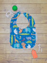 Load image into Gallery viewer, An organic Poco Bambino bib. The print is jungle animals design