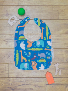 An organic Poco Bambino bib. The print is jungle animals design
