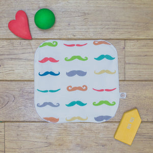 An Organic Poco Bambino reusable wash cloth / wipe in a rainbow mustaches print.