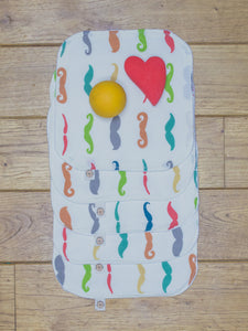 A set of 5 Organic Poco Bambino reusable wash cloths / wipes in a rainbow mustaches print