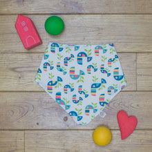 Load image into Gallery viewer, An organic Poco Bambino dribble bib. The print is a multicoloured toucan design.