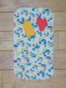 A set of 5 Organic Poco Bambino reusable wash cloths / wipes in a toucan tango print.